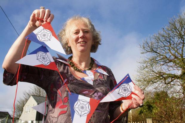 TOUR-INSPIRED: Carol Watson with some of her bunting mixing the French tricolour with the Yorkshire rose.