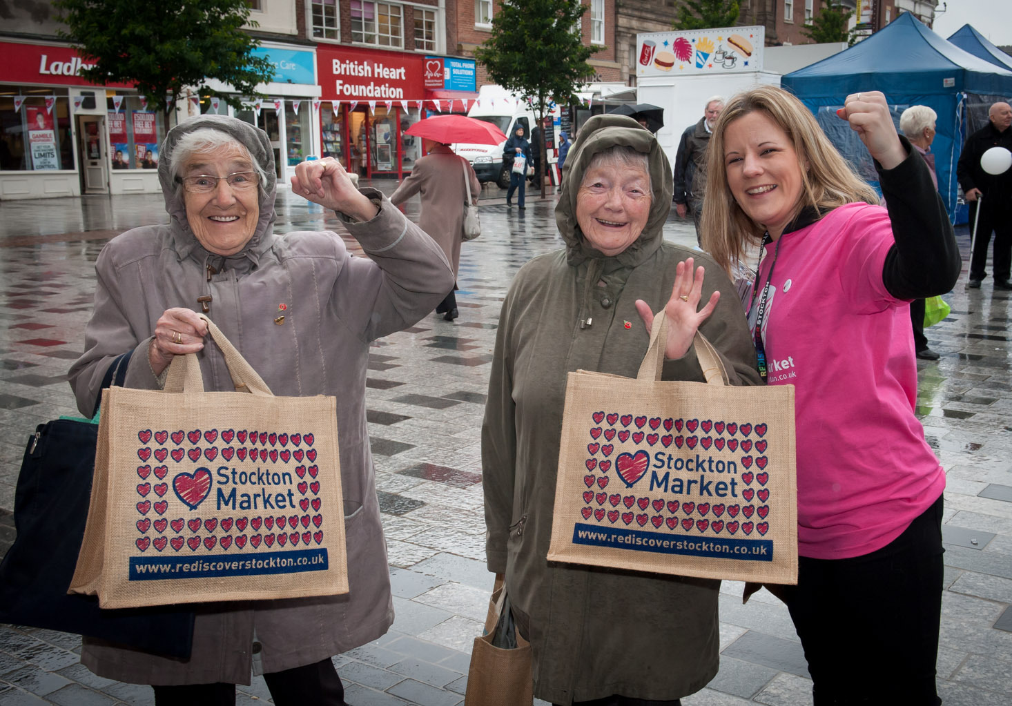 MARKET GIVEAWAY: Two lucky shoppers are given a bag full of freebies