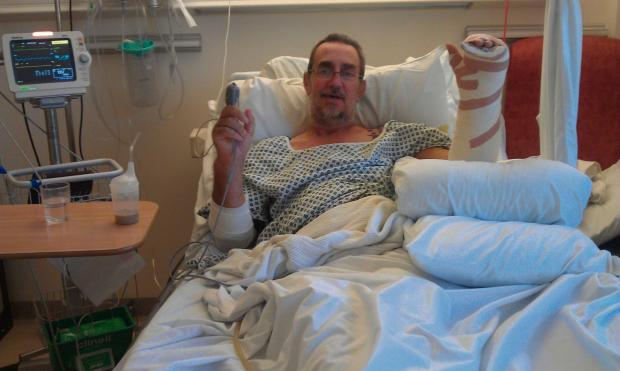 SERIOUS INJURIES: David Lodge manages a smile from his hospital bed despite suffering multiple injuries