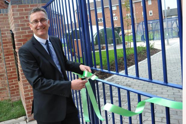 Darlington and Stockton Times: JOB DONE: Dave Pickard, director of operations for Thirteen, officially opens the revamped communal area in Fairfield, Stockton