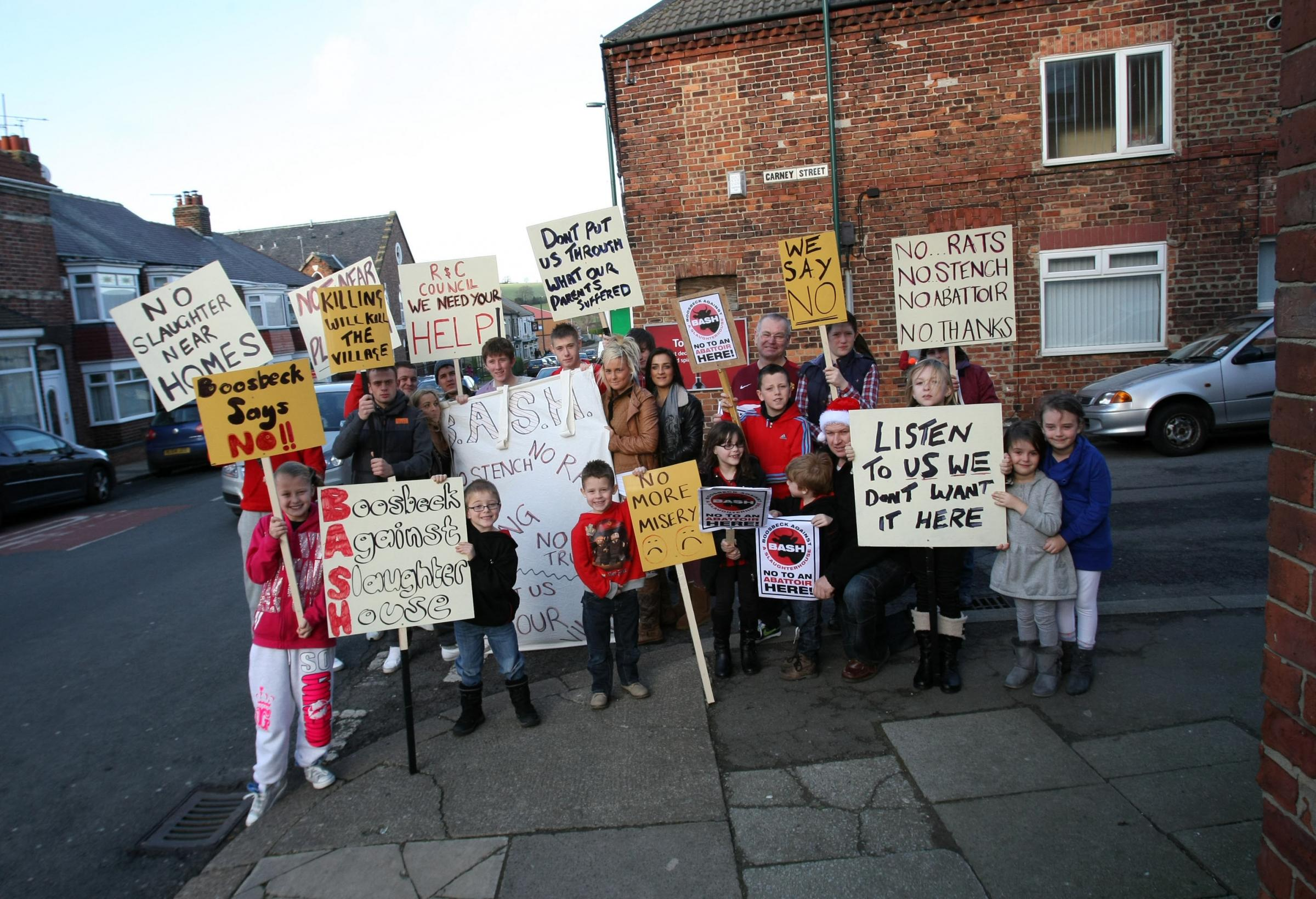 Residents of Boosbeck protesting against the re-opening of a slaughterhouse on the high-street.