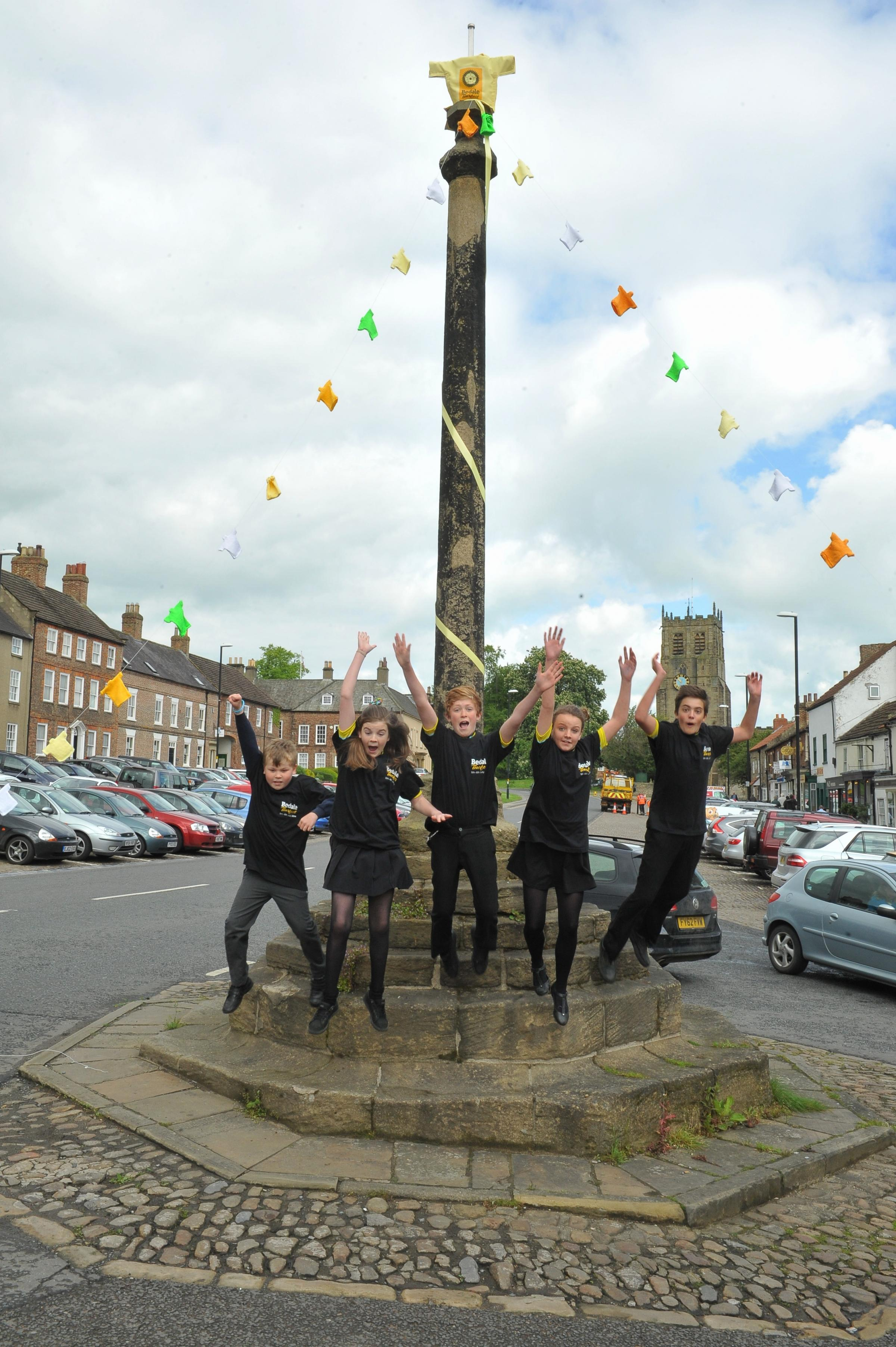Tour ready:  Ned Reed, Cloe Gibbons, John Estensen,  Katie Simmons and Louis Keane help decorate the market cross