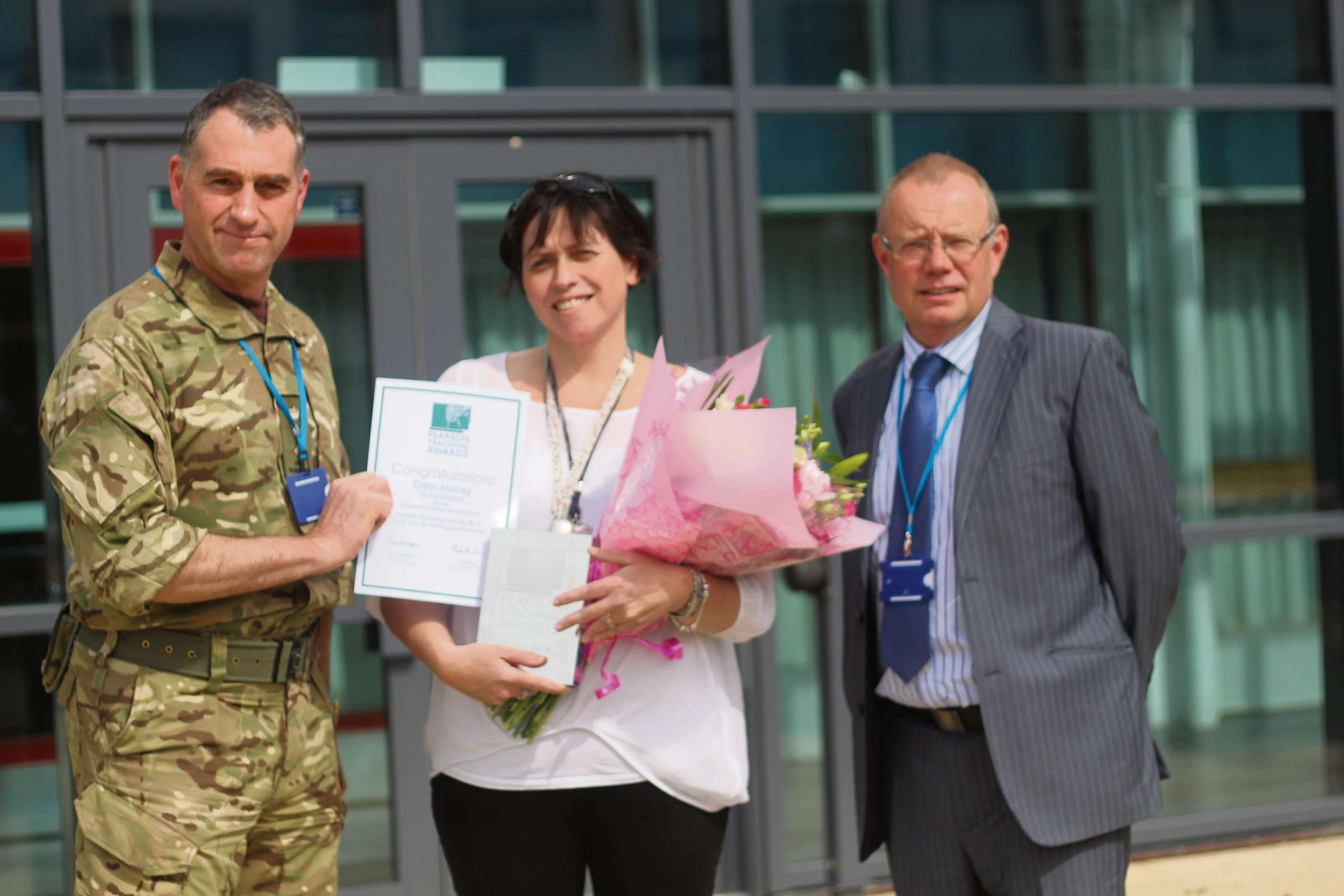 Top teacher:Carys is presented with her award by Col Stephen Padgett and Headteacher Ian Robertson