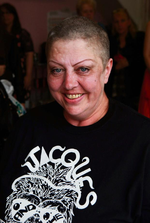 Darlington and Stockton Times: SHAVE & DIP: Anti-knife campaigner Theresa Cave shaves off her hair  to raise money for a caravan that will be used to enable vulnerable  youngsters to enjoy a holiday. Picture: SARAH CALDECOTT