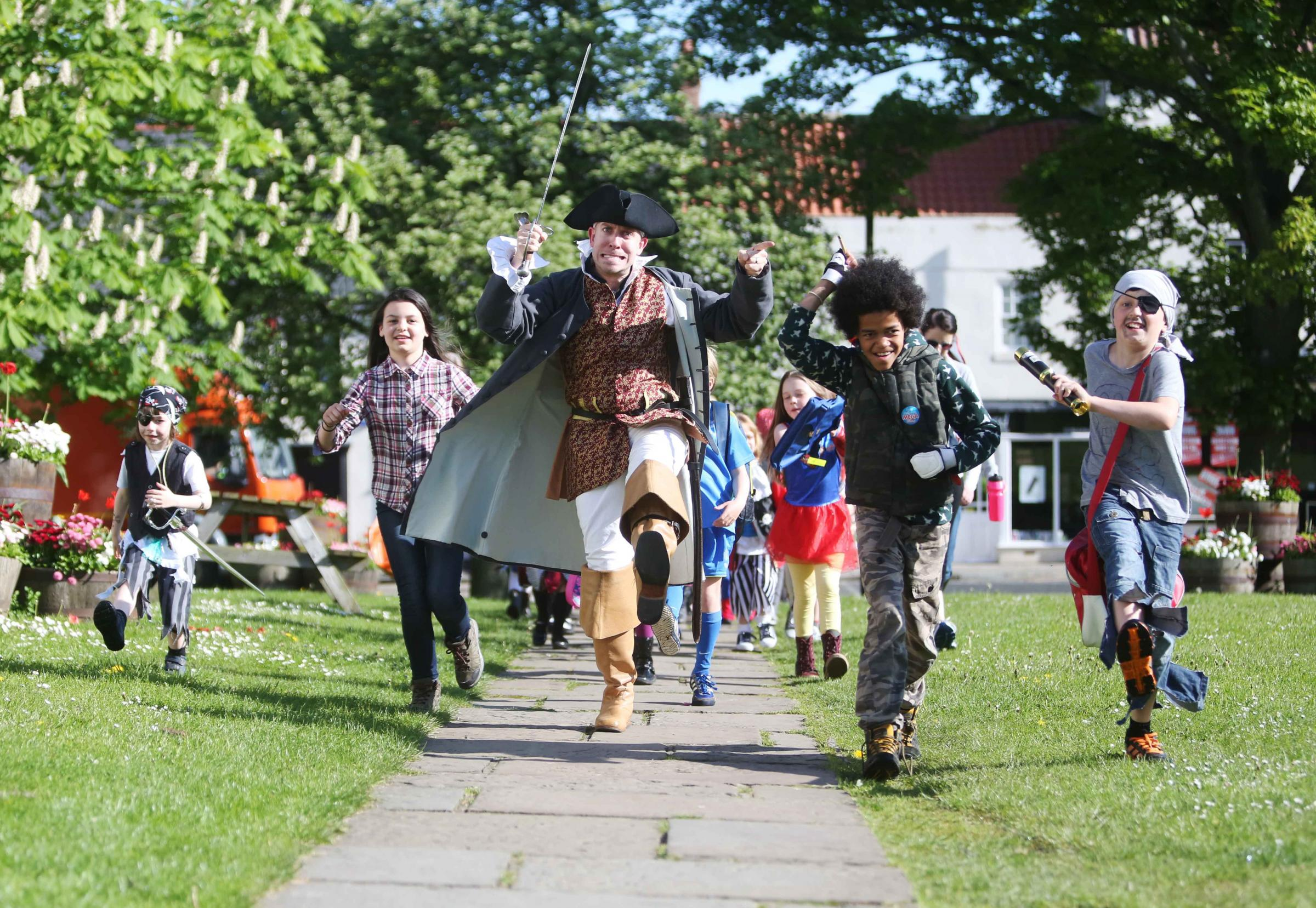 THEMED WALK: Pirate Dave Elliot Cooper from Histrionics drama company with Harry Gething, six, Elise Cabanes-Bouveng, 11, Joshua Delapanosta and Daniel Turnbull, both ten