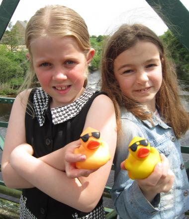 Youngsters Amy Hughes and Isobel Yeadon with the ducks they were unable to race in the River Tees