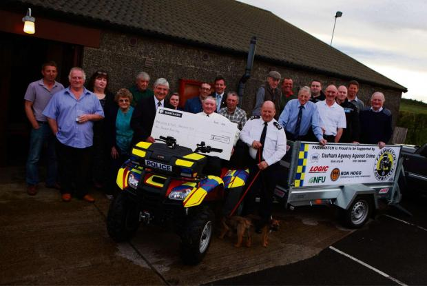 FARM WATCH: A Celebration  to mark 25th anniversary of the Farm Watch initiative at Marwood Social Centre pictured front PCC Ron Hogg hands a cheque for £4000 to Farmer and founder member Peter Stubbs and Chief Constable Mike Barton. Picture: SARAH