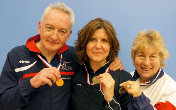 Fencers Anton Pollard, Beth Davidson and Carole Seheult with their medals