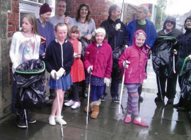 CLEAN UP: Youngsters take part in the community litter pick around the Borough Road area of Darlington