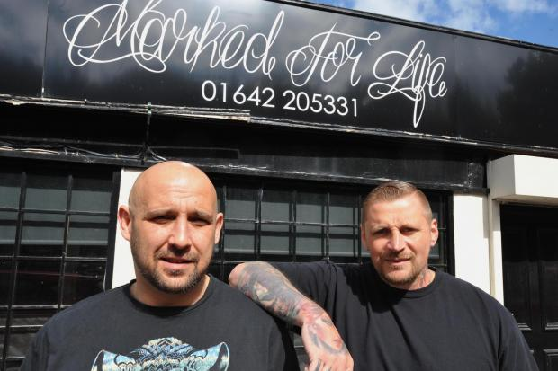 FRIEND IN NEED: Ian Richardson, left, with tattoo artist Mark Bester, one of the main organisers of his fundraising events