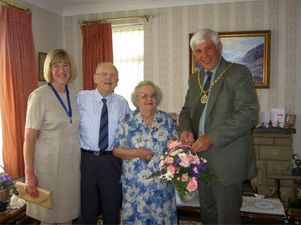 Darlington and Stockton Times: HAPPY ANNIVERSARY: Mr and Mrs Ferry are presented with a bouquet by Hambleton  District Council's vice-chairman Stephen Dickins and his wife Margaret.