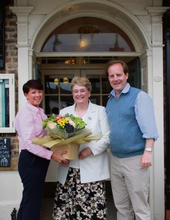 LONG SERVICE: Joanne Lee, manager of The Golden Fleece, congratulates head of housekeeping Kathleen Hall, with Homfray Hotels director Richard Murray Wells
