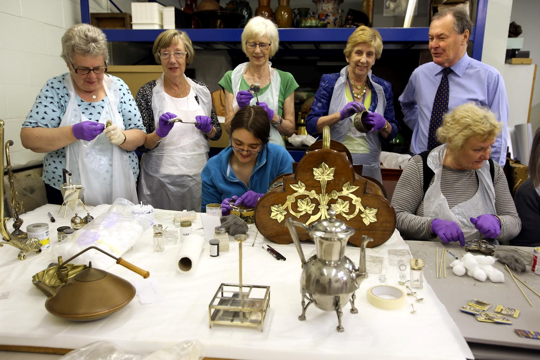 SUMMER CLEAN: Members of the Linthorpe W.I. at the Dorman Museum on Linthorpe Road, Middlebrough give the antique Dresser pottery a clean.  Pictured are Pauline Coates, Mary Ellis, Margaret Stephenson, museum volunteer Lauren Eccles (sitting), cl