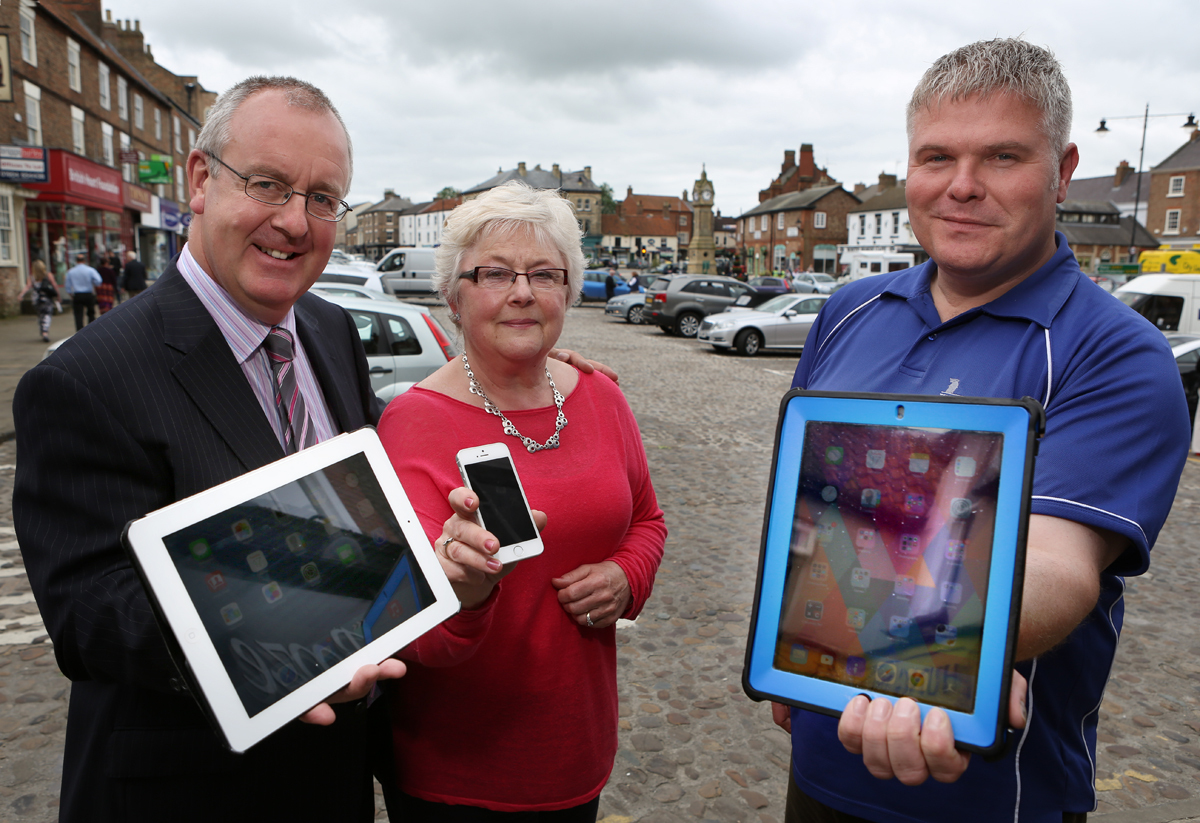 WEB ACCESS: Councillor Mark Robson, Jill Miller, of Thirsk and District Business Association and Andrew Newton, of Telecom Yorkshire, test electronic devices in Thirsk town centre