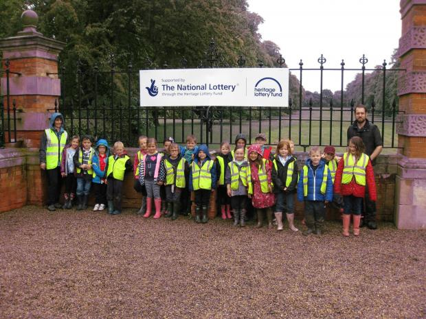 HISTORY LOVERS: Year two children from Bolton-on-Swale St. Mary's Primary Church of England School with teaching assistant Wendy Parr and archaeologist Jim Brightman.