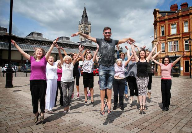 Darlington and Stockton Times: DANCE ON: Dance tutors and dancer Darrien Wright give a preview of the Mass Dance to be held in Darlington on 12th July.       Picture: ANDY LAMB