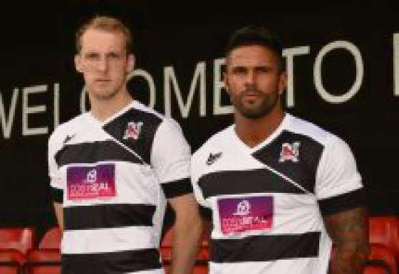 NEW LOOK: Darlington players Gary Brown and Leon Scott model the new home shirt