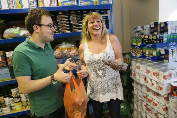 FOODBANK: Karen Scott gets a food parcel from volunteer Ac Coltman at the foodbank at King's Church
