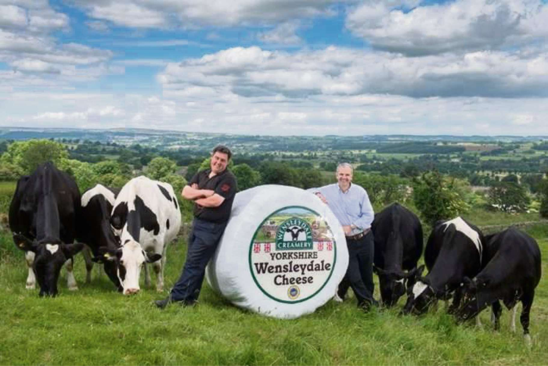 SAY CHEESE: Wensleydale dairy farmer Kevin Clarkson, left, and Wensleydale managing director David Hartley celebrate Le Grand Fromage