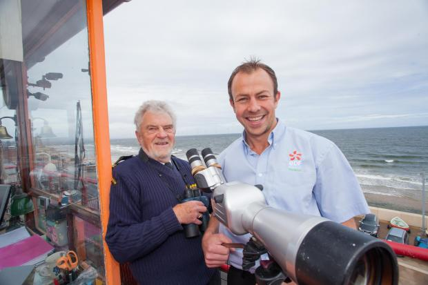 WATCHTOWER FUNDING: Trevor Smith (left) of Coastwatch Redcar with James Wilson of EDF Energy Renewables at the watchtower.