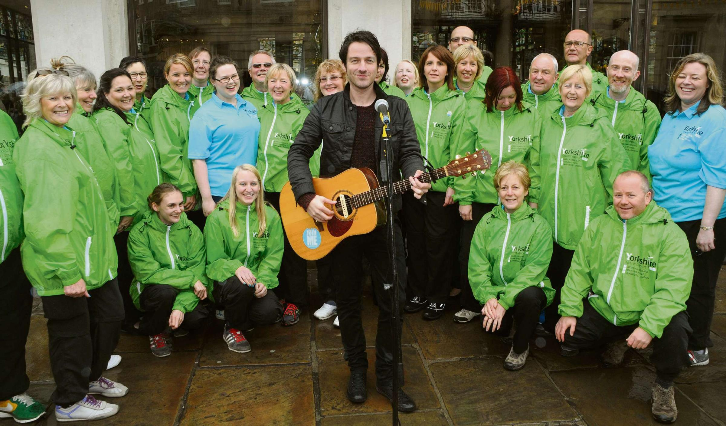 TOUR ANTHEM: Alistair Griffin sings his Grand Depart song, The Road, along with the Tour Maker Choir outside Bettys Tea Rooms, in York