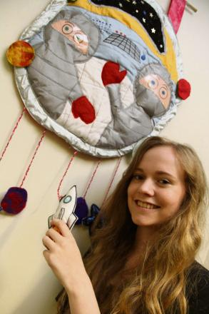 SPACE ART: Emily Renwick, 16, with her space travel interactive wall hanging