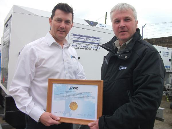APPOINTED: Richard Ogden, managing director of Yorkshire Generators, of Boroughbridge, receives official Gold Dealer status from SDMO's Steve Tullett