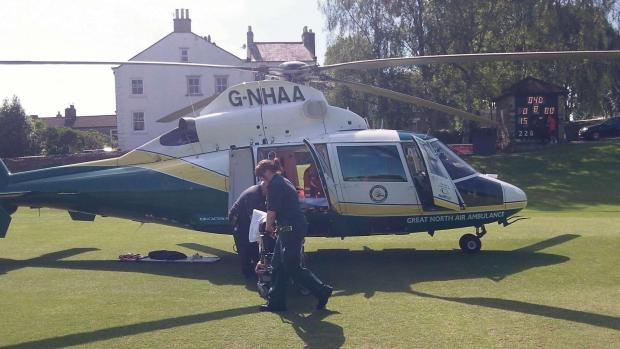The air ambulance lands on the cricket pitch