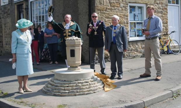 OPENING STAGE: From left, Mayoress of Harrogate borough Councillor Shirley Fawcett, Masham town crier John Todd, chairman of Masham Parish Council Councillor Andrew Burrell, Mayor of Harrogate borough Councillor Jim Clark unveil the cairn
