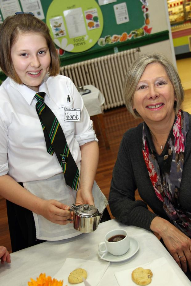 Darlington and Stockton Times: COFFEE TIME: Niamh Wheldon, 12, serves her grandmother Jennifer Davies at the charity coffee morning.