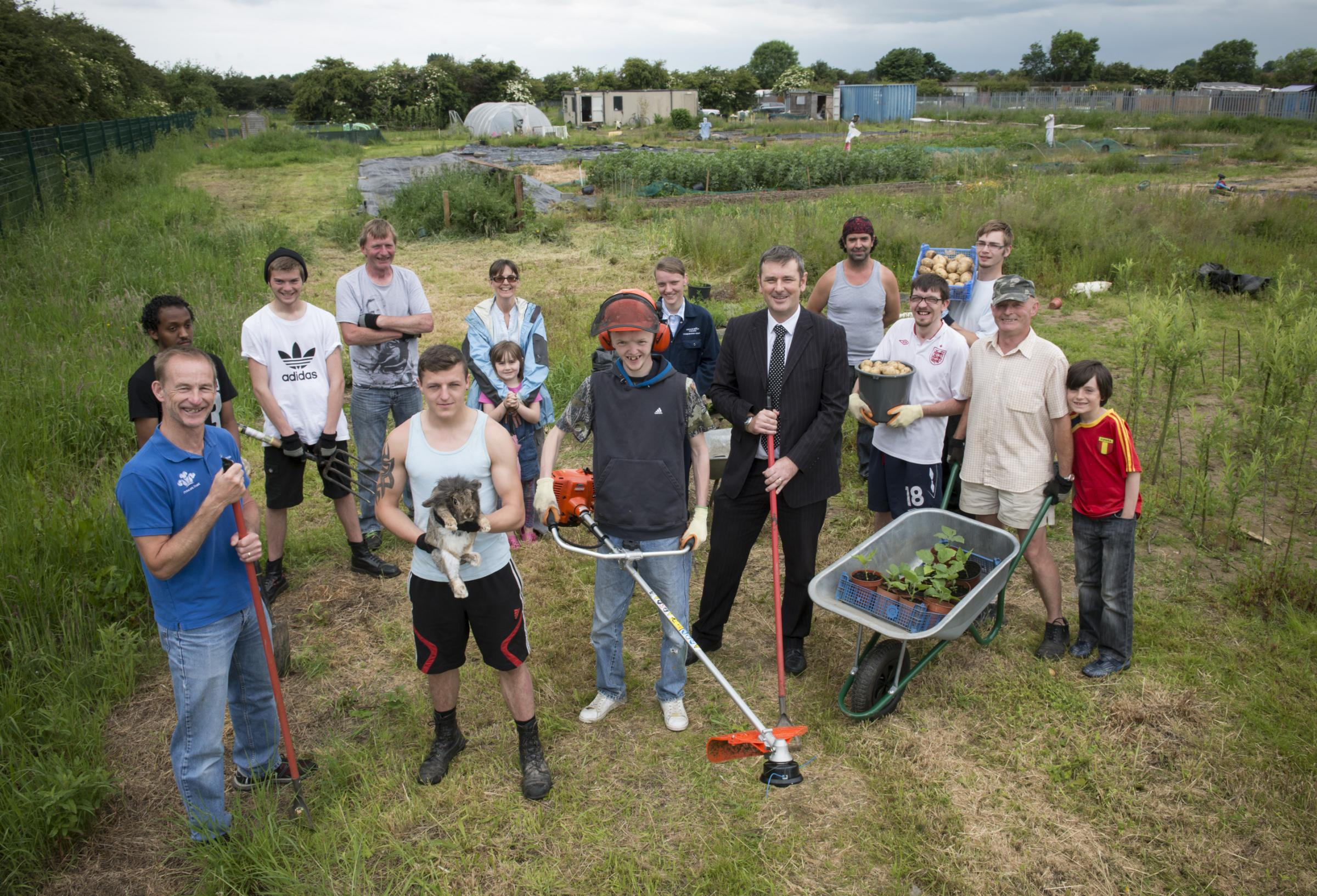 CROP ROTATION: Peter Taylor (fourth from left, front) of UK Steel Enterprise lends a hand at the allotments with Martin Copley (front left) and members of The Prince's Trust Team and the Harmony Growing Project.
