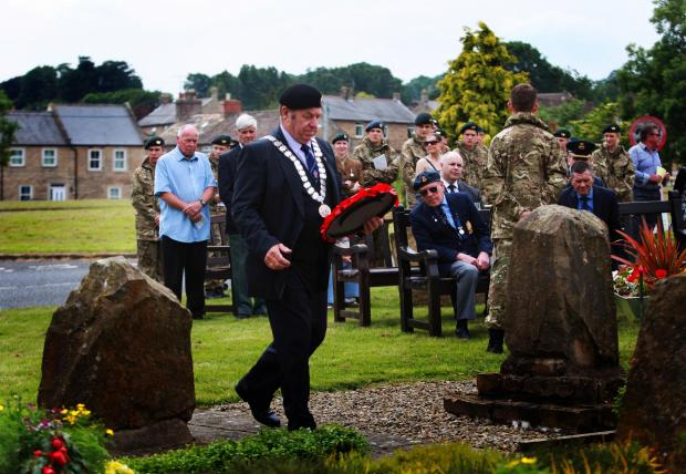 AVIATION DAY: John Blissett Mayor laying a wreath atTeesdale Aviation Day service at The RAF memorial, in the grounds at Deerbolt YOI, in Barnard Castle, Picture:SARAH CALDECOTT
