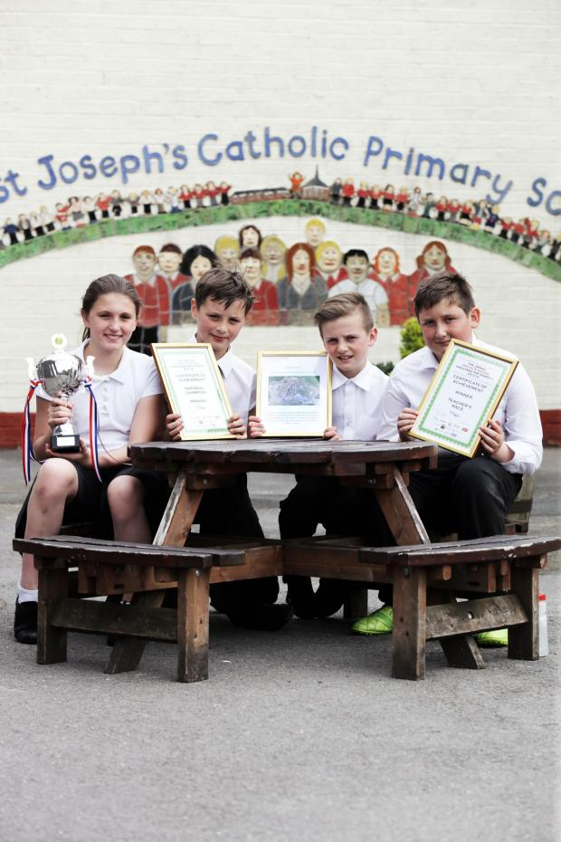 Darlington and Stockton Times: COMPETITION WINNERS: St. Joseph's RC Primary school pupils, Erin Donnelly, Alex Smith, Sam Conway and Harry Lawson with their trophy and certificates. Picture: STUART BOULTON.