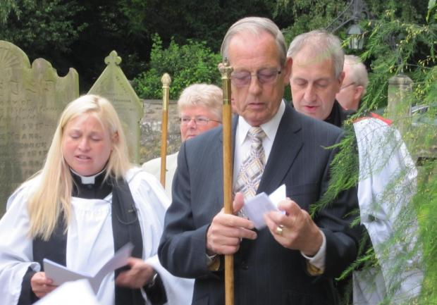 NEW VICAR: The Reverend Jenni Lane, left, arrives at Croft church in a procession headed by churchwarden Les Baker, right