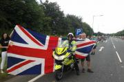 RELAXED ATMOSPHERE: A police officer poses for a photograph with fans beside Ripon bypass