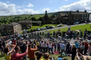 HUGE SUPPORT: Thousands of spectators lined the streets of Reeth as the peloton passed through on the opening stage of the Tour de France