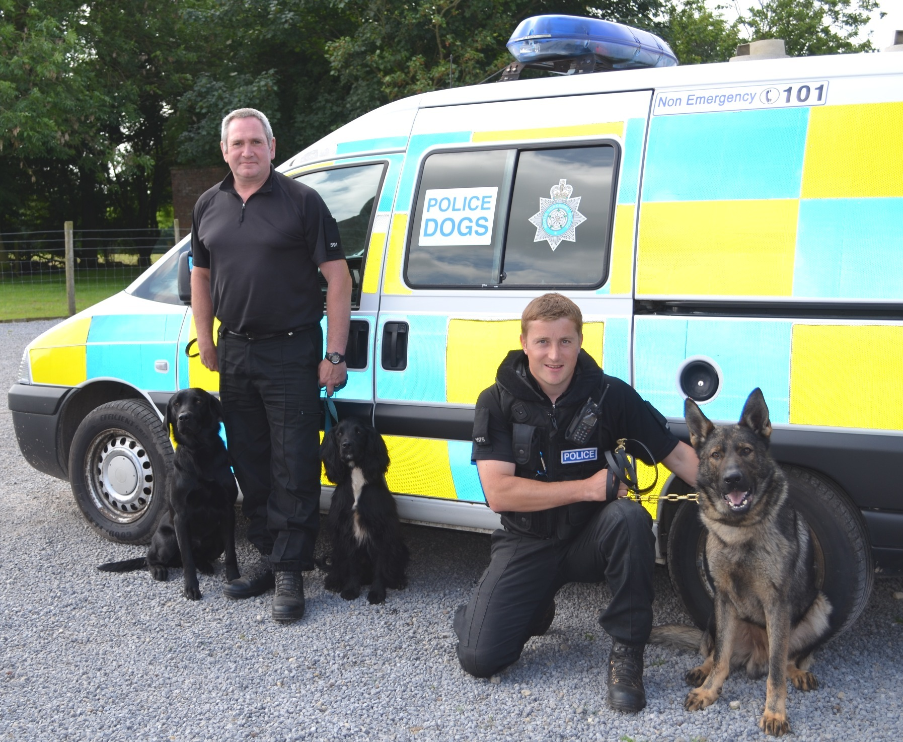 ALL CHANGE: Left, PC Vince Gillon with trainee police dogs Jacob and Atom and PC Martin Gayles with PD Thor.