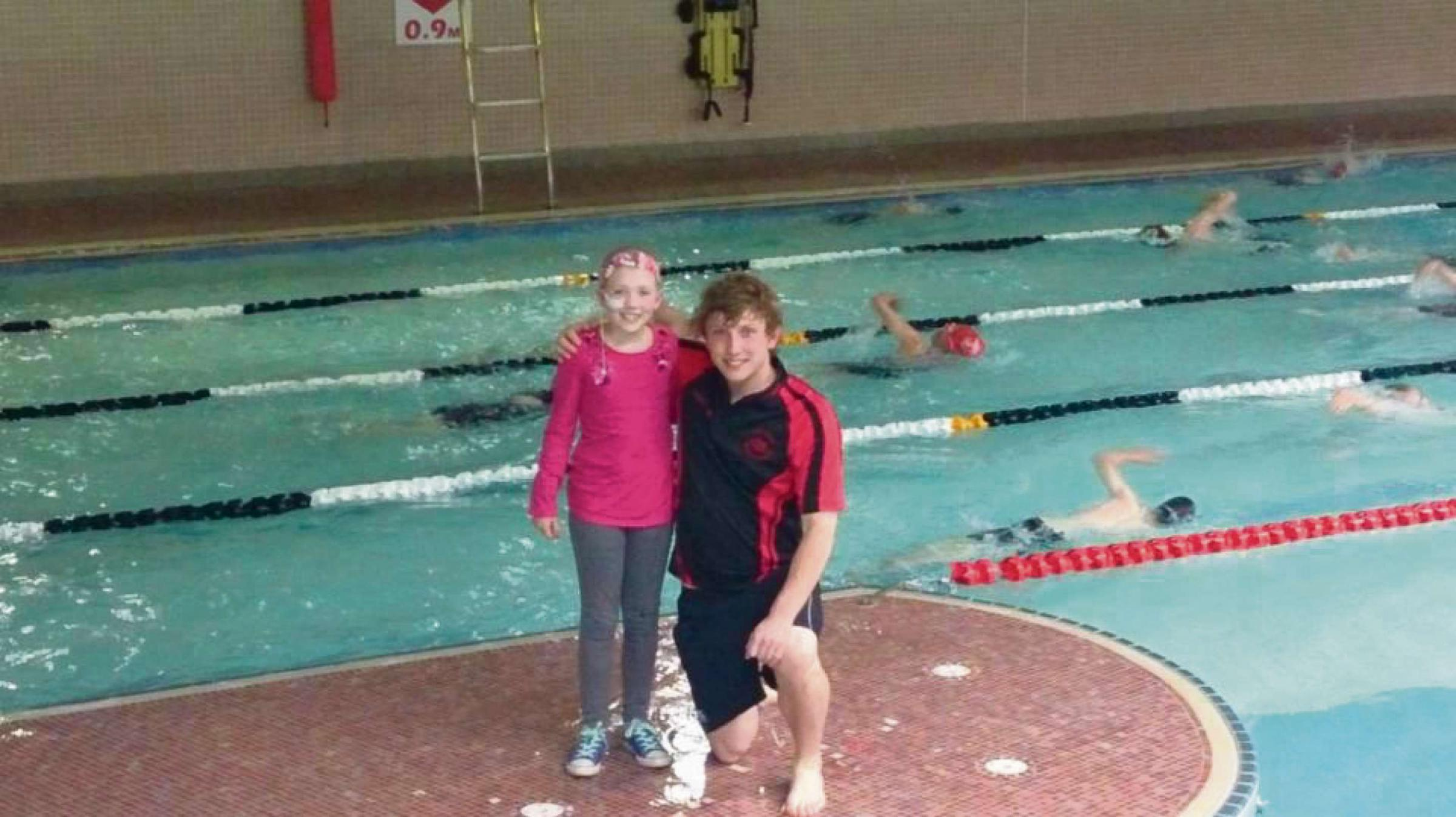 GREAT LENGTHS: Gaby Alderson with Northallerton Amateur Swimming Club head coach Greg Ient at the sponsored swim