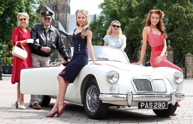 Darlington and Stockton Times: ABSOLUTE CLASSICS: Preview for the Croft Nostalgia weekend.  Julie Scorer, Mike Scorer, Amy Scorer, Alice Widdows and Lucy Scorer pictured with 1958 MG A 1500 roadster (supplied by Simon J Robinson) in Darlington market square.  Picture: CHRIS BOOTH (8111