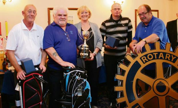 WELL DONE: The Friends of Darlington Memorial Hospital golf team receiving their winning trophies. From left: John Eager, Jim Morris, Anne Wiper presenting the trophies, Mark Brown and John Beadle
