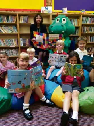 READING FUN: Councillor Cyndi Hughes launches the summer reading challenge with pupils from Whinfield School