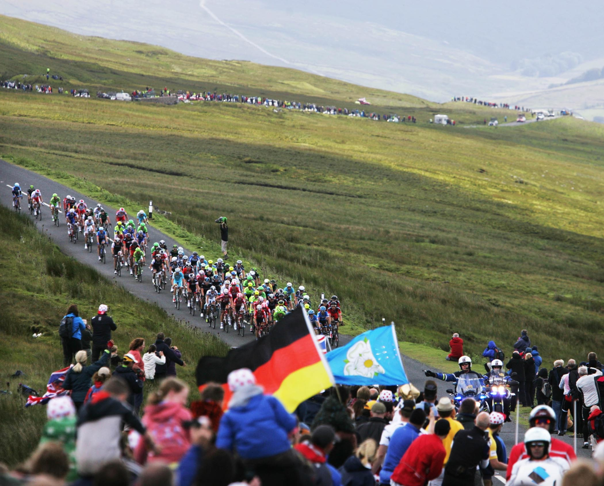 LE TOUR: The peloton makes it's way over Buttertubs Pass in the Yorkshire Dales. Work now needs to begin on capitalising on the exposure Yorkshire received in order to boost tourism, says head of tourism network