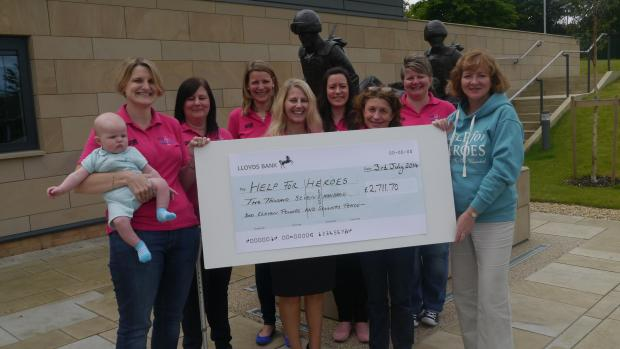 CD SALES: Phoenix House executive officer Melanie Dickinson received the cheque from members of the Military WAGS choir