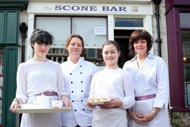 Darlington and Stockton Times: TEA AND SCONES: New cafe with an Edwardian theme set up in the market square at Richmond.  Pictured outside are Emily Whitfield 16, Lesley Metcalf, Freya Metcalf ,11, and Jane Whitfield.