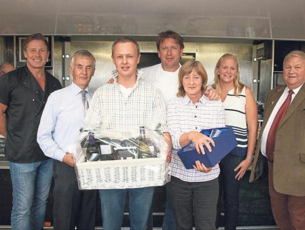 WINNING STEAKS: Winners Richard and John Cussons from Robin Hoods Bay with Jim Viggars, left, and James Martin, centre back, and Asda and ABP representatives
