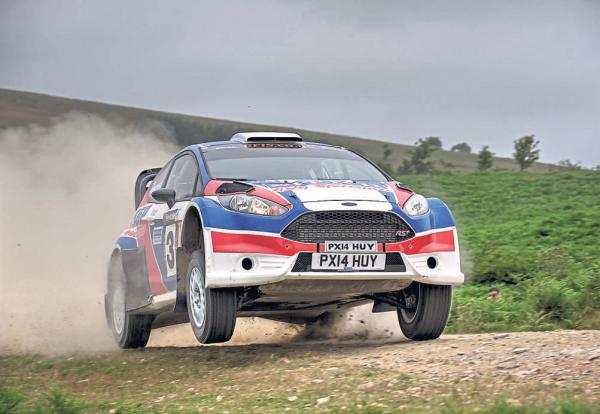 OVER THE HILL: Stephen Petch (Ford Fiesta) and Matthew Robinson (Ford Escort) in action on the Nicky Grist Stages Rally. Stuart Woodier – www.rallyaction.co.uk