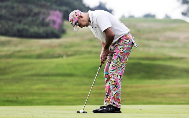 TROUSER ROUSER: Boxer Stuart Hall putts on the 18th during a charity tournament at Saltburn Golf Club.