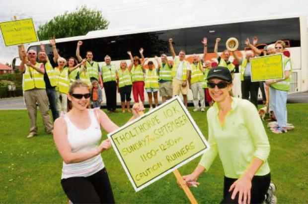RUN APPEAL: Dionne Reid and Eileen Morley with villagers promoting the Tholthorpe 10k run