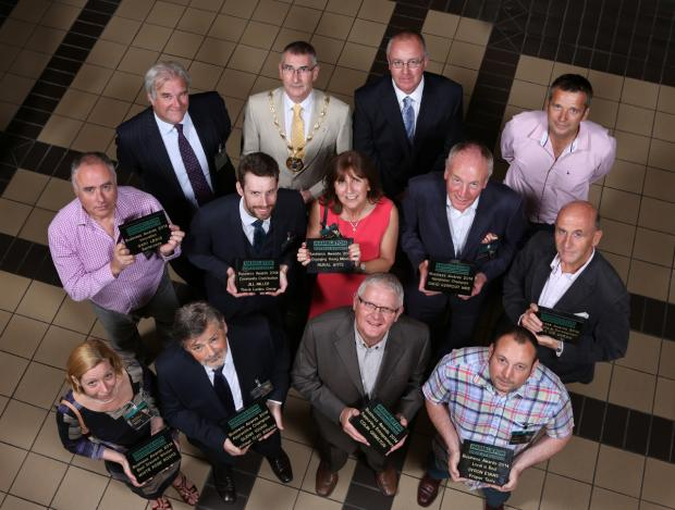BUSINESS FIRST: The Hambleton Business Awards winners with Hambleton District Council leaders and Neil Collinson, of Dales of Thirsk, who designed the trophies.
