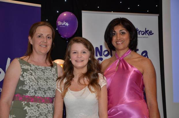 INSPIRATIONAL YOUNGSTER: Emily Simpson being presented with her award by Dr Satinder Sanghera and Emma Fitzimmons from Synergie Physiotherapy Clinic, who sponsors the award.
